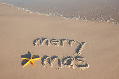 Merry Xmas. Written on a beach. Australia Stock Image