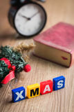 Merry Xmas written in wooden cubes color  on a desk Royalty Free Stock Photography