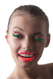 Merry young disco girl winks at camera Royalty Free Stock Photos