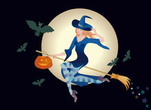 Merry young witch with a pumpkin Stock Image