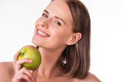 Merry young woman with apple Stock Photos