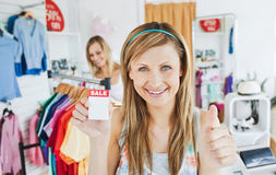 Merry young woman holding a  Stock Photography
