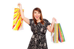 Merry young woman holding shopping bags. Isolated on white background Stock Photography