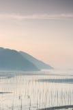 Mers de Siapu et travailleurs peu profonds de tidelands Photographie stock libre de droits