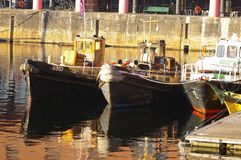 Mersey Boats 01. A group of small fishing boats moored within Liverpool's dock complex Royalty Free Stock Photo