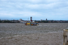 The Mersey Ferry to Birkenhead from the Albert Dock in Liverpool in Merseyside in England Royalty Free Stock Photos