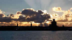 Mersey Sunset. View looking west across the Mersey river from Liverpool towards Birkenhead at sunset royalty free stock photography