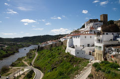 Mertola castle and town facing Guadiana river. Stock Images