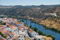 Mertola city on the riverside of Guadiana and the bridge on the Royalty Free Stock Photography