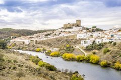 Mertola cityscape with uphill castle in Alentejo, Portugal. Mertola cityscape with an uphill castle and white architecture, Alentejo, Portugal Royalty Free Stock Photo