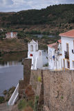 Mertola street over with guadiana in background Stock Photos