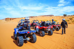 Merzouga, Morocco - Feb 26, 2016: back view on group of off-road Royalty Free Stock Images