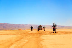 Merzouga, Morocco - Feb 22 2016: convoy of off-road vehicles (4x Stock Photo