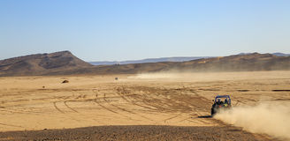 Merzouga, Morocco - Feb 25, 2016: panoramic view on convoys of offroad cars in Morocco desert near Merzouga. Merzouga is famous fo. R its dunes, the highest in Stock Photos