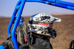 Merzouga, Morocco - February 25, 2016: Man riding buggy car in desert. Merzouga, Morocco - February 25, 2016: Man riding blue RZR800 buggy car in desert and Stock Photography