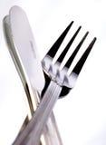 Mes en vork op wit Stock Foto