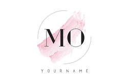 MES M O Watercolor Letter Logo Design con el modelo circular del cepillo Imagen de archivo libre de regalías