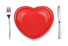 Mes, rode plaat in hartvorm en vork Royalty-vrije Stock Foto