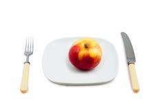 Mes, stop en plaat met een appel Stock Fotografie