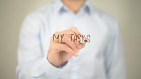 Mes tâches, écriture d'homme sur l'écran transparent Photo libre de droits