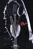 Mes, vork, lepel, en water Royalty-vrije Stock Foto