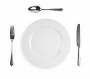 Mes, vork, plaat en lepel Stock Fotografie