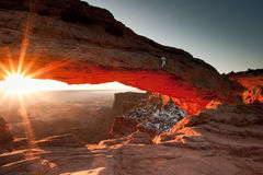 Mesa Arch. At Sunrise with Sunburst Below Arch Stock Photo