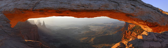 Mesa arch at sunrise. Mesa arch gets red light at sun rise Stock Photos