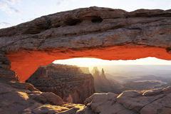 Mesa Arch Sunrise - Canyonlands National Park. The iconic sunrise view of Mesa Arch, in the Island in the Sky district of Canyonlands National Park in Southern Stock Photos