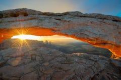 Mesa Arch at sunrise in Canyonlands National Park, Utah. Sunrise at Mesa Arch in Canyonlands National Park near Moab, Utah, USA Stock Photo