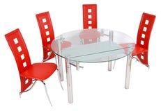 Mesa de comedor y sillas de cristal Foto de archivo