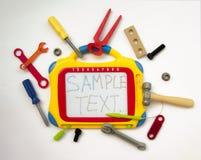 Mesa de projeto magnética com brinquedos das crianças, ferramentas, chave inglesa, ha Fotos de Stock Royalty Free