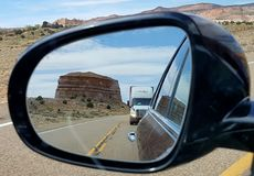 Mesa in rear view mirror, Utah Stock Images