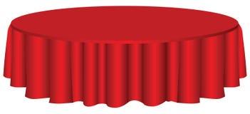 Mesa redonda con el mantel Foto de archivo libre de regalías