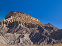Mesa rising above the desert. The Book Cliffs near Grand Junction in western Colorado Royalty Free Stock Image