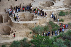 Mesa Verde Tour Group. Visitors are taken on an educational tour through Cliff Palace in Mesa Verde National Park Stock Image