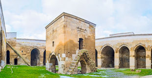 The mescit in Caravan Saray. AGZIKARAHAN, TURKEY - JANUARY 19, 2015: The small mosque (mescit) in the middle of Agzikarahan Caravan Saray with the stairs Stock Image