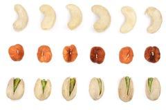 Mescoli i pistacchi matti delle nocciole degli anacardii isolati su fondo bianco Vista superiore Disposizione piana Fotografia Stock