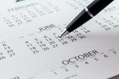 Mese di settimana di giorno del pianificatore della data di calendario fotografie stock