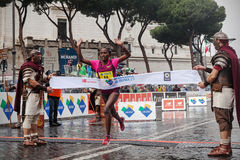 Meseret Kitata Tolwak while crossing the finish line first at the Rome Marathon Stock Image