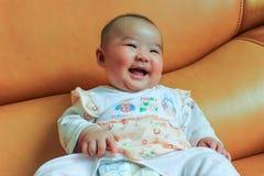 4 meses de sorriso velho do bebê Fotografia de Stock Royalty Free