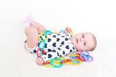 2 meses preciosos de bebé con el juguete Fotos de archivo libres de regalías