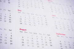 Meses y fechas en calendario Imagen de archivo libre de regalías
