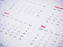 Meses y fechas en calendario Fotos de archivo libres de regalías