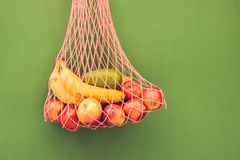 Mesh bag of fruits royalty free stock photos