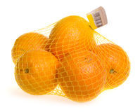 Mesh bag of oranges Royalty Free Stock Photography