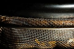 Mesh for brewing tea of an antique teapot macro. Mesh for brewing tea of an antique teapot close Royalty Free Stock Photos
