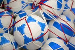 Mesh candy in the form of soccer balls royalty free stock photos