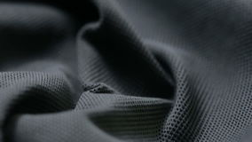 Mesh cloth. black synthetic fabric. can be used as a background stock video