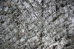 Mesh & concrete Stock Image